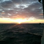 Sun sets over the L'Atalante in the Tasman Sea