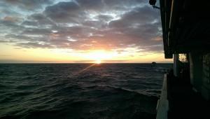 Sun sets over the L'Atalante in the Tasman Sea